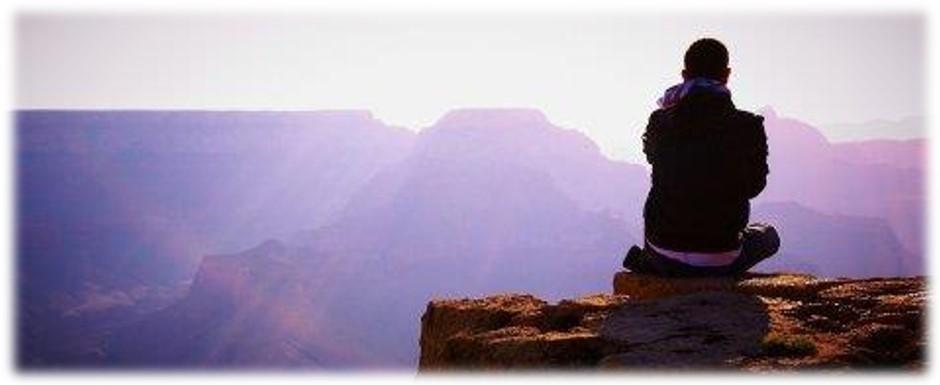 meditating man on mtn