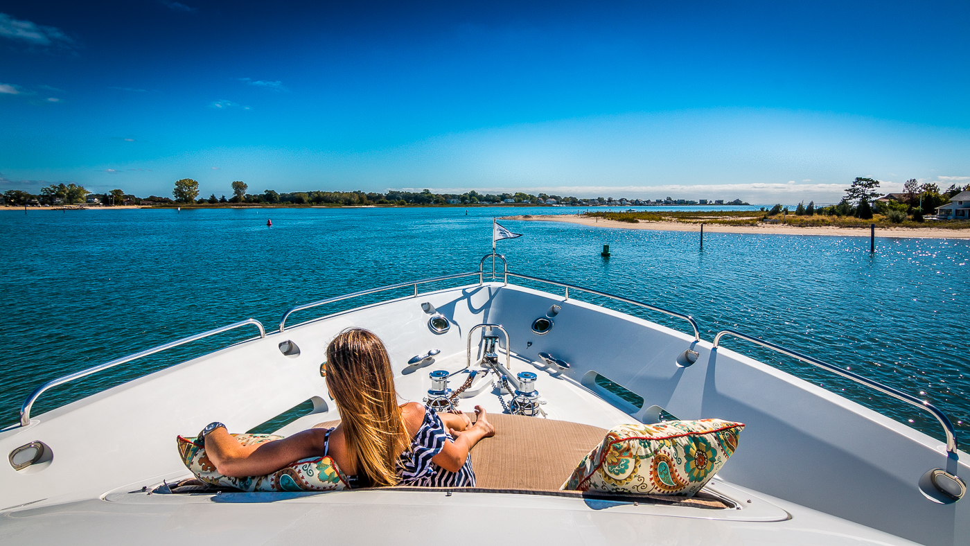 Woman relaxing on a private yacht charter with beautiful ocean view.