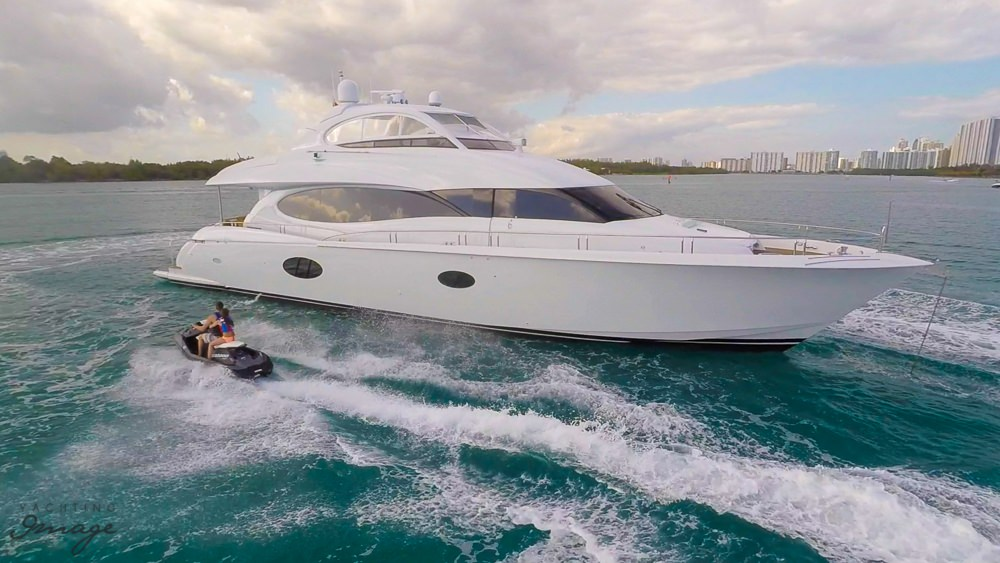 Sleek motoryacht Chip with someone passing by on a waverunner